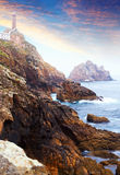 Ocean rocky coast with lighthouse Stock Image