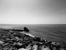 The ocean and rocky shore in black and white Royalty Free Stock Photos