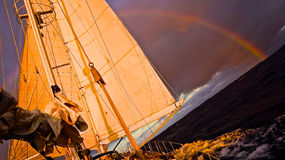 Ocean sailing and rainbow Royalty Free Stock Photography