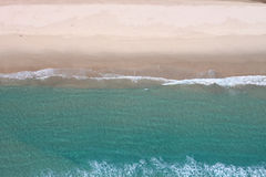 Ocean & Sand Aerial. Aerial image of pristine ocean and sandy beach. Perspective is straight down royalty free stock photo