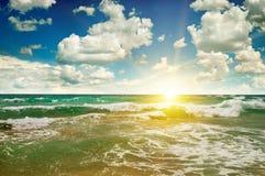 Ocean, sandy beach, blue sky and sunrise Royalty Free Stock Images