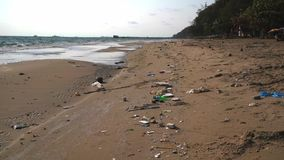 Ocean sandy beach heaped with garbage. Ecological concept. Ecological catastrophy royalty free stock photos
