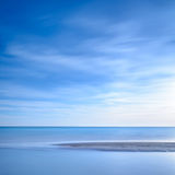 Ocean sandy beach line and blue sunset Royalty Free Stock Photo