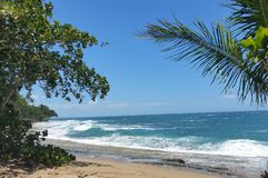 Ocean at Sandy Beach in Rincon. Blue skies, ocean scene on a sunny day Royalty Free Stock Images