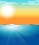 Ocean scene with blue sea and bright sun Royalty Free Stock Images