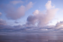Ocean scene with colourful overcast sky Royalty Free Stock Photography
