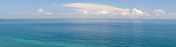 Ocean scenery. In panorama in daytime under blue sky Royalty Free Stock Photo