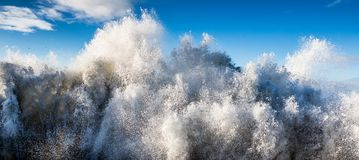 Ocean sea water crashing tsunami wave. Abstract closeup big large crashing stormy ocean tsunami water wave stock photography