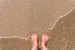 Ocean Sea Waves And Girl Feet On Sandy Beach Royalty Free Stock Photos
