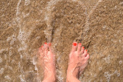 Ocean Sea Waves And Girl Feet On Sandy Beach Royalty Free Stock Photo