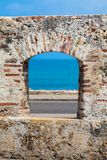 Ocean seen through the embrasure of the city walls in the Cartagena. De Indias stock images
