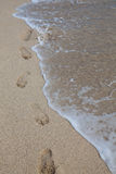 Ocean and send. Traces on the white sand Stock Photo