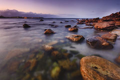 Ocean SHelly Set Magen. Sydney australia manly shelly beach wet rocky stones at sunset transparent surf blurred waves with long exposure Royalty Free Stock Photos
