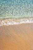 Ocean shore. Gentle waves splash onto a golden shore Royalty Free Stock Photos