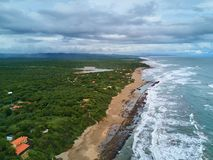 Ocean shore beach with rocks. Aerial view in cloudy day Stock Photo