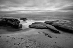 The Ocean Shore. A long exposure photo of waves crashing on the rocky shores of La Jolla beach in California Royalty Free Stock Images
