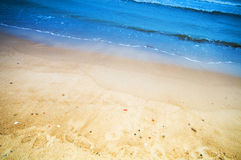 Ocean shore, sand and waves Royalty Free Stock Photo