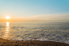 Ocean shore at sunrise Stock Images