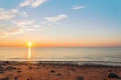 Ocean shore at sunrise. (Cape Breton, Nova Scotia, Canada Stock Image