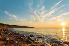 Ocean shore at sunrise. (Cape Breton, Nova Scotia, Canada Stock Photography