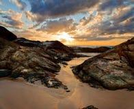 Ocean shore at sunset Stock Image