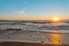Ocean shore at sunset Stock Photography