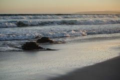 Ocean shore with two rocks and waves Stock Image