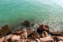 Ocean shore. Wave splash in ocean against beach reef Stock Images