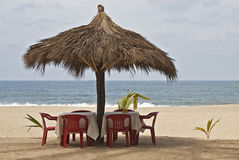 Ocean-side palapa table setting Stock Photos