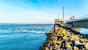 Ocean side view of the concrete structure of the Storm Surge Barrier. Built in the province of Zeeland, in the Netherlands to prevent flood disasters as that in stock image