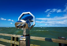 Ocean sightseeing. With binoculars Royalty Free Stock Image