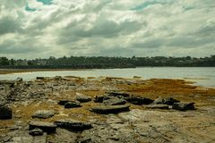 Ocean and sky over the rocks at Ulladulla stock image