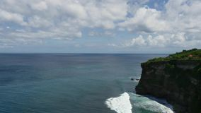 Ocean sky rocks waves in the tropical forests of Indonesia. Overall plan. Paradise. Ideal for background stock footage
