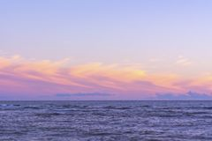 Ocean and sky at sunset, horizon line. Minimalism in the landsca stock photo