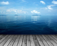 Ocean with sky and wood floor Royalty Free Stock Photos
