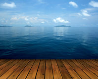 Ocean with sky and wood floor Stock Photography