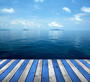 Ocean with sky and wood floor Stock Photos