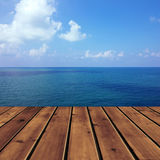 Ocean with sky and wood floor Royalty Free Stock Images