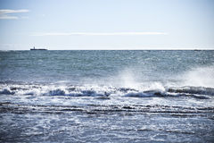 Ocean with Small Island. The beach in Djupivogur, eastern Iceland Royalty Free Stock Photos
