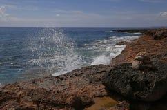 Ocean spindrift over limestone rocks Royalty Free Stock Photo