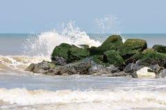 Ocean splash. The oceans surf splashing into a breaker Royalty Free Stock Images