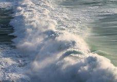 Ocean Spray. Large breaking ocean wave lit by low afternoon sunlight Stock Photo