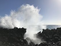 Ocean spray. Ocean crashing onto Hawaiian lava rock cliffs Stock Photos
