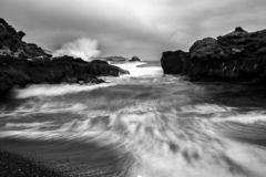 Ocean Spray and Surge in Black and White California Coastal Seascape. Sea surges and sprays in motion in black and white California coastal seascape royalty free stock image