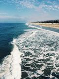 Ocean from standing on pier point of view stock photography