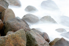 Ocean stones. Stones in the water in denmark shot with slow shutter speed royalty free stock photo