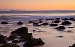 Ocean sunrise. Sunrise over a rocky beach in Queensland, Australia Royalty Free Stock Photo