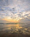 Ocean Sunrise. Beautiful sunrise reflecting on the sandy beach Stock Images