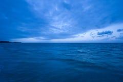 Ocean on sunrise. Calm ocean and clouds on sunrise Royalty Free Stock Photos