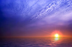 Ocean sunrise background image. Beautiful landscape of sky and water at Sunset Stock Photos